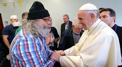 Pope Francis greets Aidan Walsh at the Capuchin Day Centre on Bowe Street in Dublin. Photo: Damien Eagers