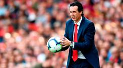 Arsenal head coach Unai Emery said he would take full responsibility if any of Ozil's team-mates are subsequently taken ill. Photo by Clive Mason/Getty Images