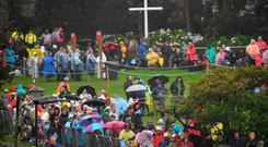 The faithful wait in the rain ahead of a visit from Pope Francis to Knock Shrine. REUTERS/Dylan Martinez