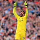 Alisson celebrates Liverpool's winning goal at Anfield last on Saturday. Photo by Simon Stacpoole/Offside/Getty Images