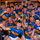 Tipperary players celebrate in the dressing room with the James Nowlan Cup after their BGE All-Ireland U-21 final win. Photo: Sportsfile