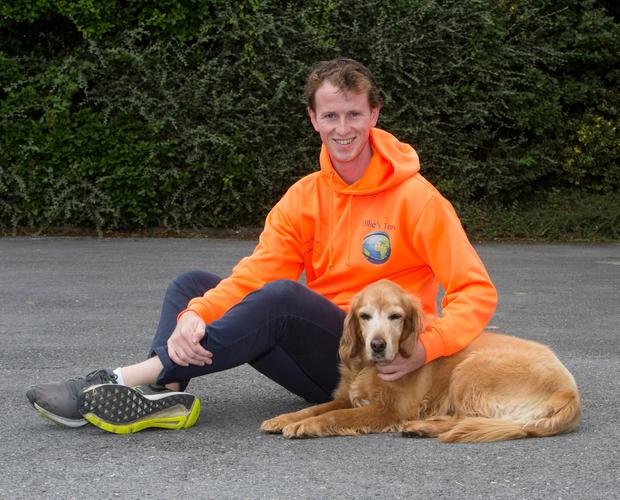 Ollie Gleeson with his dog, Lady. Photo: Liam Burke/Press 22
