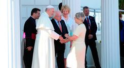 Pope Francis meets Children's Minister Katherine Zappone, along with President Higgins and his wife Sabina. Photo: PA