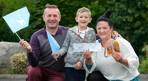 Piotr, Mariola and Ryan (7) Palichleb were given tickets while in Knock. Photo: Damien Eagers