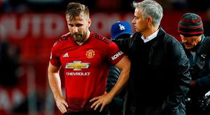 Manchester United's Luke Shaw and manager Jose Mourinho after the match