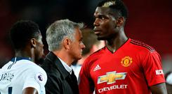 Jose Mourinho (C) speaks to Paul Pogba (R) after the final whistle last night