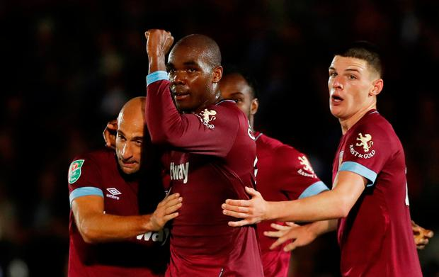 Soccer Football - Carabao Cup Second Round - AFC Wimbledon v West Ham United - The Cherry Red Records Stadium, London, Britain - August 28, 2018 West Ham's Angelo Ogbonna celebrates scoring their second goal with team mates Action Images via Reuters/Matthew Childs