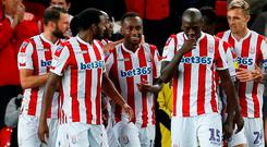 Stoke City's Saido Berahino celebrates scoring with team mates last night