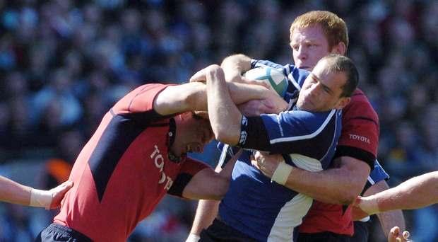 23 April 2006; Felipe Contepomi, Leinster, is tackled by Paul O'Connell, right, and David Wallace, Munster. Heineken Cup 2005-2006, Semi-Final, Leinster v Munster, Lansdowne Road, Dublin. Picture credit: Pat Murphy / SPORTSFILE