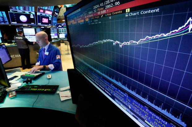 US stocks held at fresh records in early trading yesterday, with technology shares pacing gains, as investors awaited the next developments on trade. (AP Photo/Richard Drew)