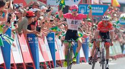 Simon Clarke celebrates as he crosses the finish line in first place, followed by Bauke Mollema, at the end of the fifth stage of La Vuelta Tour of Spain, from Granada to Roquetas de Mar. Photo: AFP/Getty Images