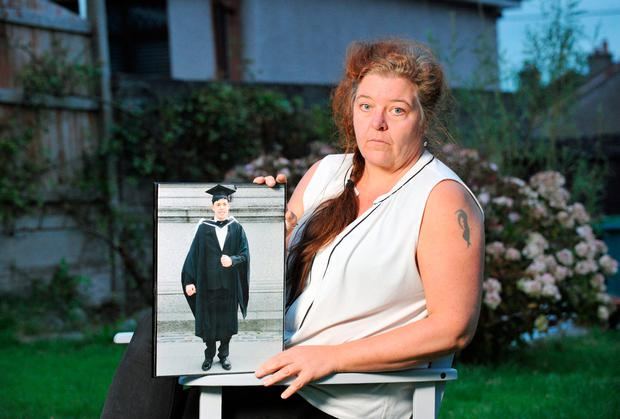 Fanny Binder, who has flown to Greece, with a photo of her son Sean at his university graduation. Photo: Darragh McSweeney