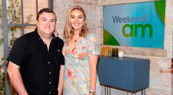 Simon Delaney and Anna Daly on their new 'Weekend AM' set, to coincide with the rebranding of TV3 as Virgin Media Television. Photo: Brian McEvoy