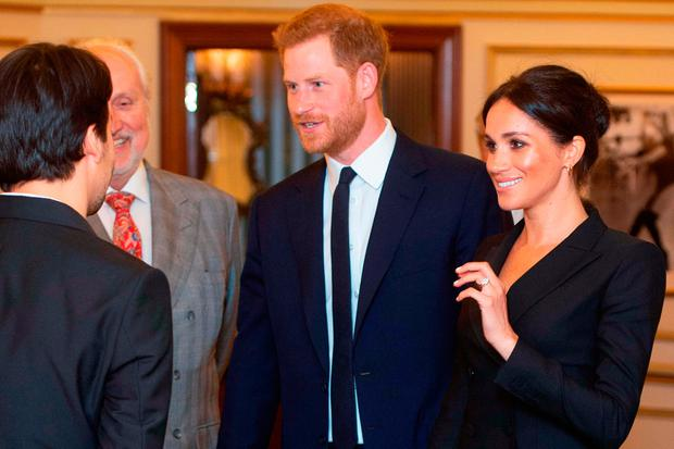 Britain's Prince Harry, Duke of Sussex (L), and Britain's Meghan, Duchess of Sussex (R) arrive to attend a gala performance of the musical 'Hamilton' in support of the charity Sentebale at the Victoria Palace Theatre in London on August 29, 2018. (Photo by Dan CHARITY / POOL / AFP)DAN CHARITY/AFP/Getty Images