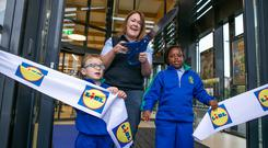 Store Manager Ruth Shanley with children Sean Cahill (1st Class ) and Julie Nkembi (3ed Class) from the nearby Scoil Aoife in the new Lidl Fortunestown. Kyran O'Brien