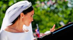 Meghan, Duchess of Sussex in the Ascot Landau carriage during the procession on The Long Walk after getting married St George's Chapel, Windsor Castle on May 19, 2018 in Windsor, England. (Photo by Richard Heathcote/Getty Images)