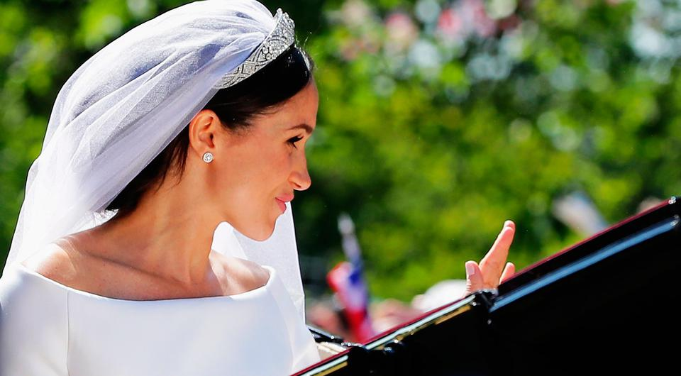 WINDSOR, ENGLAND - MAY 19: Meghan, Duchess of Sussex in the Ascot Landau carriage during the procession on The Long Walk after getting married St George's Chapel, Windsor Castle on May 19, 2018 in Windsor, England. (Photo by Richard Heathcote/Getty Images)
