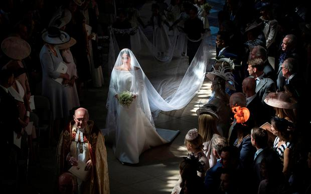FILE PHOTO: Meghan Markle walks down the aisle as she arrives in St George's Chapel at Windsor Castle for her wedding to Prince Harry in Windsor, Britain, May 19, 2018. Danny Lawson/Pool via REUTERS/File Photo