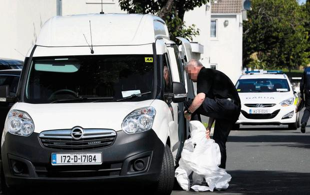 Forensic experts pictured at the scene