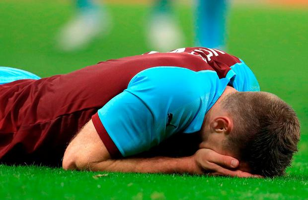 Burnley's Sam Vokes appears dejected during the UEFA Europa League Play-Off, Second Leg match at Turf Moor