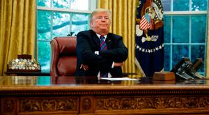 President Donald Trump tweeted that Don McGahn did not stop him from sacking Robert Mueller. Image: AP Photo/Evan Vucci