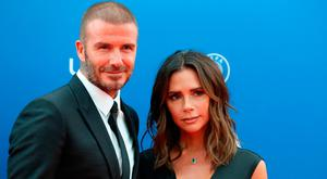 Former English football player David Beckham and his wife Victoria arrive to attend the draw for UEFA Champions League football tournament at The Grimaldi Forum in Monaco on August 30, 2018. (Photo by Valery HACHE / AFP)
