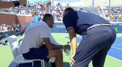 US Open umpire Mohamed Lahyani speaks to Nick Kyrgios during his second round match.