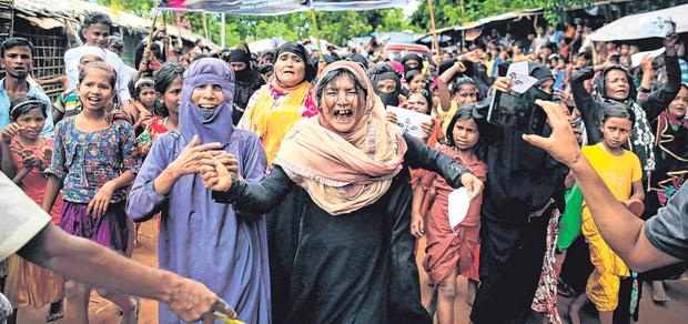 Shame: Rohingya women, in a refugee camp in Bangladesh, demand justice. Photo: AP/Altaf Qadri