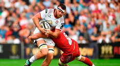 Alan O'Connor of Ulster is tackled by Josh Macleod of Scarlets during the Guinness PRO14 Round 1 match between Ulster and Scarlets at the Kingspan Stadium in Belfast.