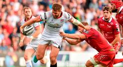 Stuart McCloskey of Ulster is tackled by James Davies of Scarlets. Photo: Oliver McVeigh/Sportsfile