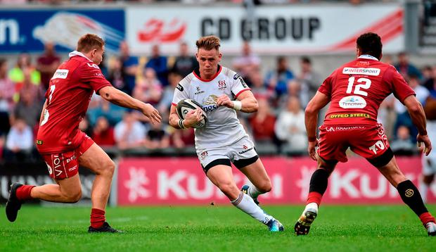 Craig Gilroy of Ulster in action against James Davies and Kieron Fonotia of Scarlets. Photo: Oliver McVeigh/Sportsfile