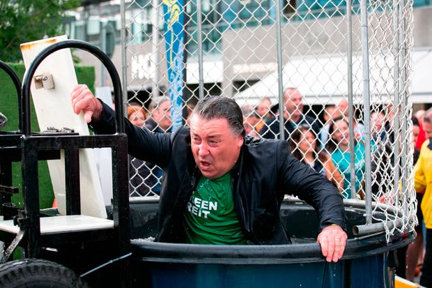 Pat Gunne gets dunked at the Docks property industry fundraiser