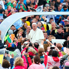 Pope Francis greets pilgrims from the Popemobile as he makes his way around the gathering at the Phoenix Park. Picture By David Conachy.