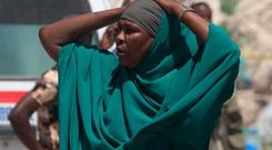 A woman reacts near the scene of a blast in the district office of Hawlwadag in Mogadishu, Somalia, September 2, 2018. REUTERS/Feisal Omar