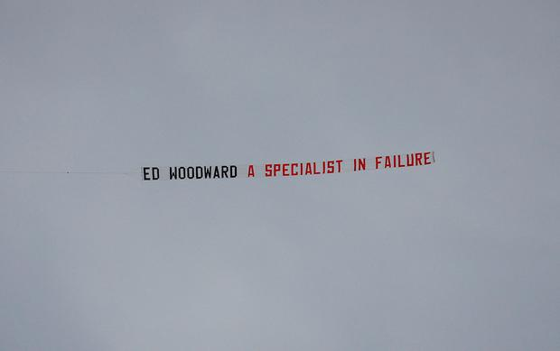 Plane banner referencing Manchester United chief executive Ed Woodward flown over the stadium before the match