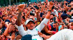 Mercedes' driver Lewis Hamilton is lifted by supporters after his victory in the Italian Grand Prix at Monza. Photo: Getty Images