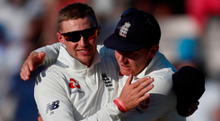 England's Joe Root and Jonny Bairstow celebrate after winning the fourth test against India. Photo: Reuters/Paul Childs