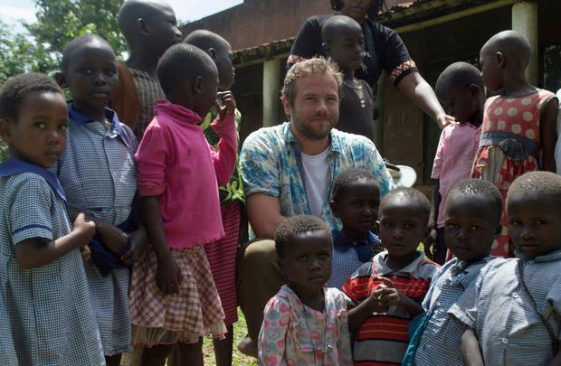 Volunteer: Actor Moe Dunford meets a group of children in Kodedema village in Kenya, during his recent visit with development organisation Self Help Africa.