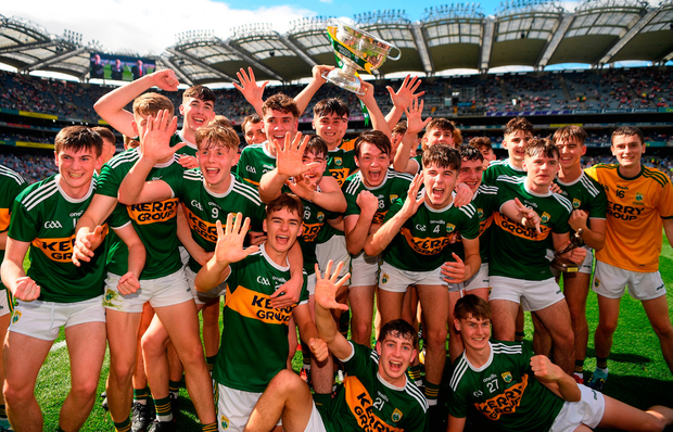 The Kerry minor team celebrate winning their fifth All-Ireland title in a row with the Tom Markham Cup. Photo by Ray McManus/Sportsfile