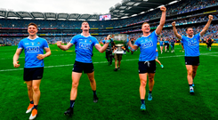 Dublin's John Small, Brian Fenton, Ciarán Kilkenny and Cormac Costello celebrate with the Sam Maguire. Photo by Ramsey Cardy/Sportsfile