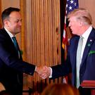 Taoiseach Leo Varadkar greets US President Donald Trump at Capitol Hill during St Patrick's Day celebrations in 2018. Photo: PA