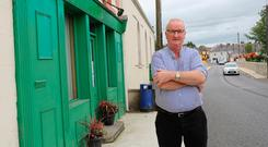 Cllr Peter McVitty pictured outside the closed down Post Office in Swanlinbar, Co. Cavan