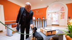 Puppy love: Artist Kevin Sharkey and his dog Spooky at Kilkenny County Council offices, where he was seeking support for the presidential election. Photo: Dylan Vaughan