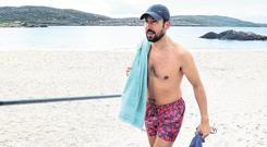 Morning dip: Eoghan Murphy after a swim at Derrynane beach in July. Picture: Frank McGrath