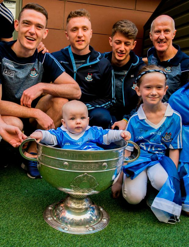 Members of the Dublin All-Ireland winning team with Liam Down (eight months) and Sinead Wheatley (7), both from Drimnagh