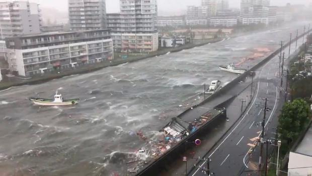 Boats float along with debris during Typhoon Jebi in Nishinomiya City, Hyogo Prefecture, Japan September 4, 2018, in this still image taken from a video obtained from social media. TWITTER/ @R10N_SR/via REUTERS