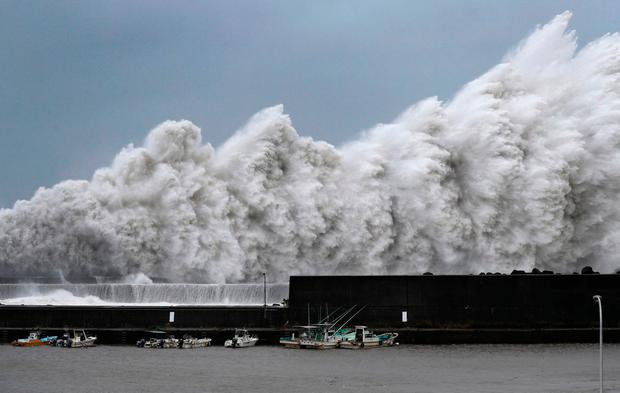 High waves hit breakwaters at a port of Aki, Kochi prefecture, western Japan, Tuesday Sept. 4, 2018. Powerful Typhoon Jebi is approaching Japan's Pacific coast and forecast to bring heavy rain and high winds to much of the country. (Ichiro Sakano/Kyodo News via AP)/Kyodo News via AP)