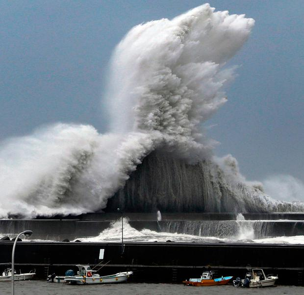 High waves hit breakwaters at a port of Aki, Kochi prefecture, Japan, Tuesday, Sept. 4, 2018. Powerful Typhoon Jebi is approaching Japan's Pacific coast and forecast to bring heavy rain and high winds to much of the country. (Ichiro Sakano/Kyodo News via AP)