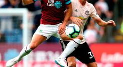 Ashley Westwood of Burnley and Nemanja Matic of Manchester United
