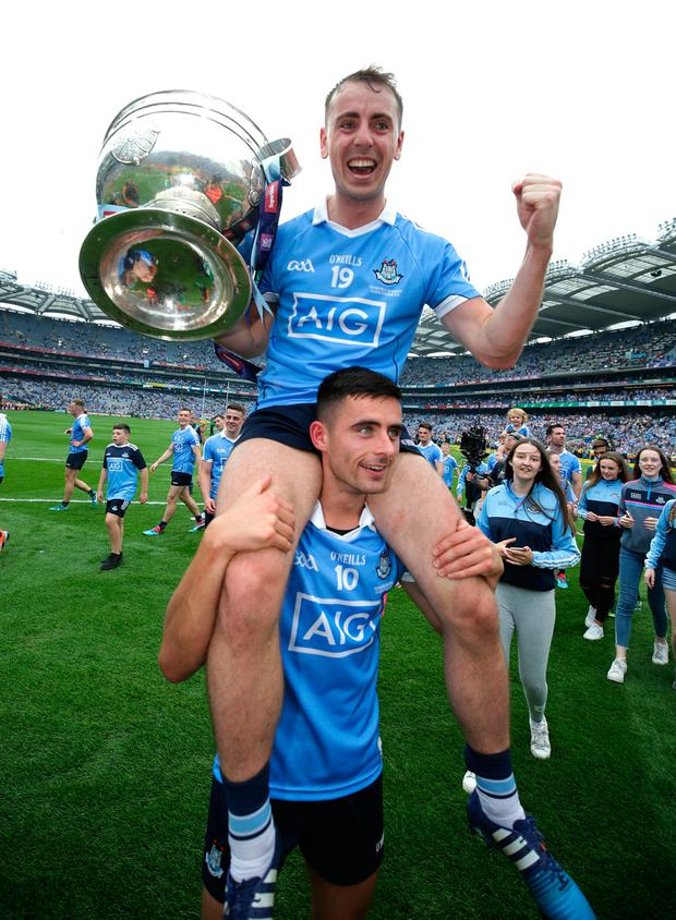 2/09/2018 Dublin's Niall Scully and Cormac Costello celebrate with the Sam Maguire cup after victory in the All Ireland football Final at Croke Park . Photo: Damien Eagers